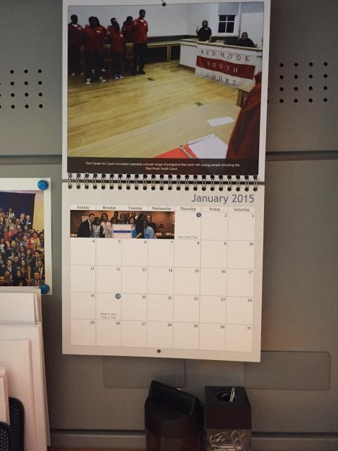 A Center for Court Innovation 2015 calendar hangs over a former Center intern's desk in the Mexican Senate. (January 5, 2015)