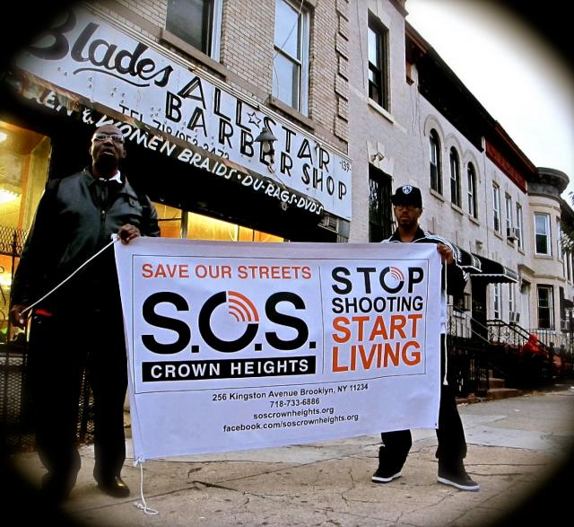 Save Our Streets (SOS) Crown Heights holds a shooting response on the corner of St. Marks Avenue  and Schnectady Avenue in Brooklyn. SOS violence interrupters, youth organizers from Youth Organizing to Save Our Streets (Y.O. SOS), and residents rallied together to show solidarity in the fight against gun violence. (October 17, 2013)