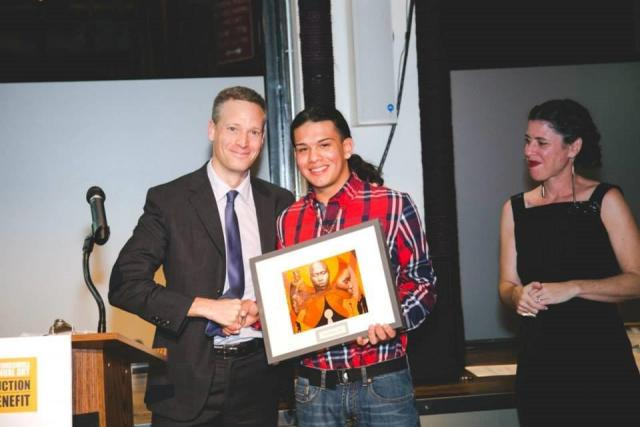 At the Groundswell Art Auction Benefit, Greg Berman accepts an award for the Center for Court Innovation from Gustavo Bahena (center), a Youth Justice Board member who also works with Groundswell, an organization that brings together artists, youth, and other organizations to use art as a tool for social change. (October 17, 2014)