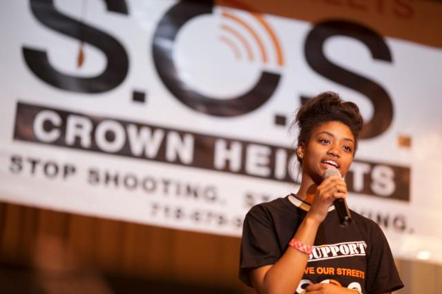 "At the annual Save Our Streets (SOS) Crown Heights ""Stop Shooting, Start Living"" Talent Show, a Crown Heights, Brooklyn resident performs a solo. Over 80 singers, rappers, poets, and dancers played to a packed house of over 400 people at PS 289. (April 24, 2013)"