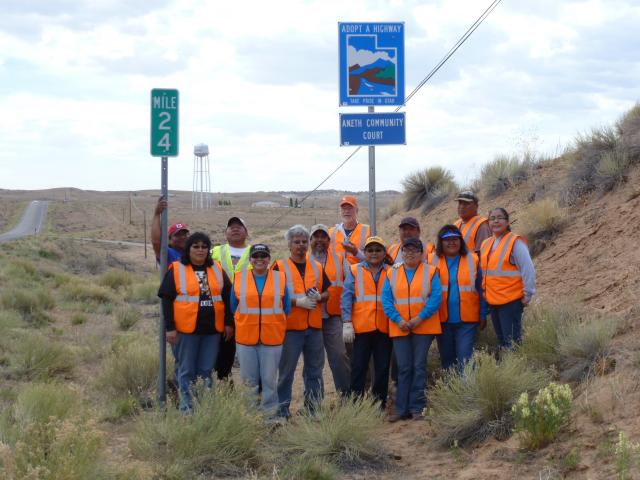 The Aneth Community Court Adopts a Highway: The Aneth Community Court, located on the Navajo Nation, was created with the help of the Center for Court Innovation's Tribal Justice Exchange and represents the first community court in Indian Country. The court recently adopted a stretch of highway in Aneth, Utah and is using highway cleanup projects for court-ordered community service and as a form of community engagement. Here, Judge Irene Black (center, yellow hat) stands with court staff and community members during an Earth Day cleanup project. (May 21, 2014)