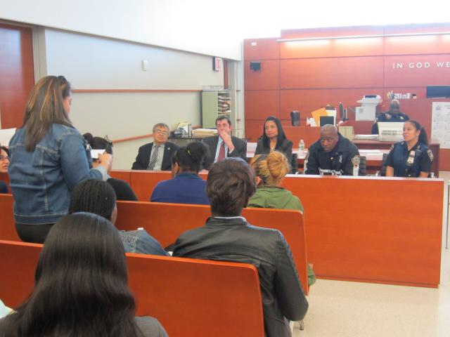 In celebration of Law Day 2013, Bronx Community Solutions held a youth forum on injustice and discrimination. Here, a senior from the High School for Law, Government, and Justice poses a question to a panel that includes (from left) Judge Efrain Alvarado, Deputy Director of Bronx Defenders Seann Riley, Narcotics Bureau Chief Assistant District Attorney Julie De León, Detective Ford of the 41st Precinct, and Court Officer Perez of the Bronx Criminal Court.(5/8/13)