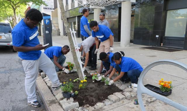 The Staten Island Youth Justice Center plants flowers as part of an adopt-the-block service project on Staten Island. Staff members and kids from across four of the Staten Island Youth Justice Center's programs participated. (June 11, 2014)