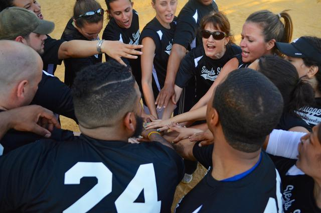 Siegel's Sluggers, whose members hail from seven Center projects, huddle during their first game of the season, which they won 11 to six! The team is named in memory of Alfred Siegel, the Center's deputy director who passed away in January. (June 6, 2014)