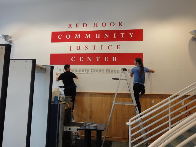 The Red Hook Community Justice Center installs new signage as part of an on-going effort to ensure that court users feel oriented and respected throughout the court process. (July 24, 2014)
