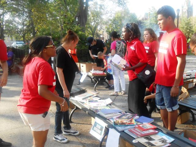 The Red Hook Youth Court sets up a book give-away at Red Hook, Brooklyn's 19th annual National Night Out Against Crime. Hundreds of Red Hook residents joined the Red Hook Community Justice Center staff and officers from the 76th NYPD Precinct in Coffey Park to strengthen partnerships that make Red Hook a thriving community and to celebrate record-low crime levels. (August 8, 2013)
