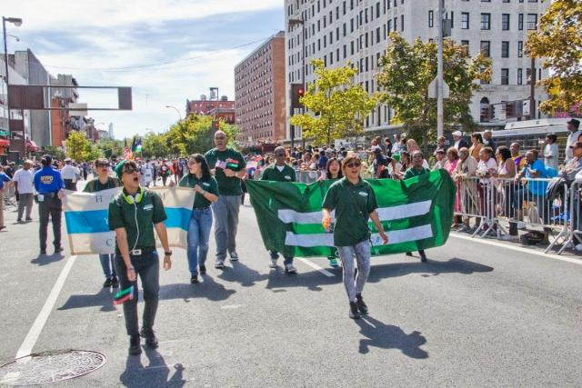 Youth court members and staff from the Harlem Community Justice Center march in the African American Day Parade. (Photo courtesy of Ernest Owens. September 18, 2013)