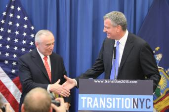 Mayor-elect Bill de Blasio shakes hands with his pick for police commissioner, William Bratton.