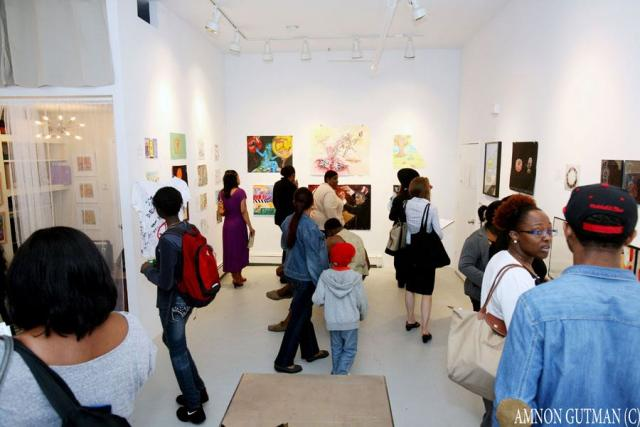 Crown Heights residents attend the Arts to End Violence art opening organized by the Crown Heights Community Mediation Center. (June 6, 2012)