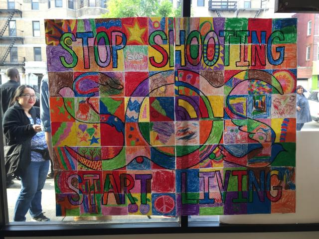 """Stop Shooting, Start Living"" art project at the annual ""Arts Against Violence"" exhibit of the Crown Heights Community Mediation Center."