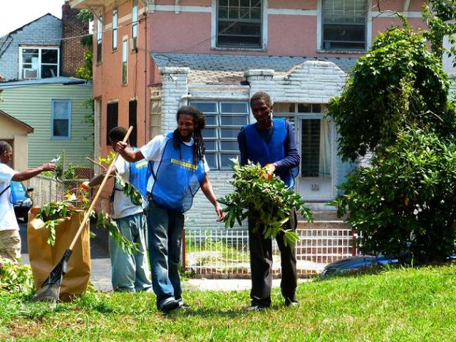 Newark Community Solutions participants clean up an Adopt-A-Lot site on Elizabeth Avenue in Newark. (August 22, 2012)