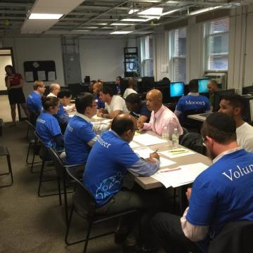 Volunteers from Moody's Investors Service and New York Cares provide UPNEXT participants with professional training.