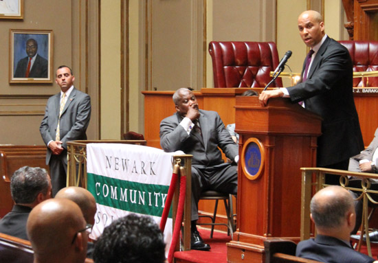 Newark Mayor Cory A. Booker speaks in the Municipal Council Chambers at the opening ceremony of Newark Community Solutions.