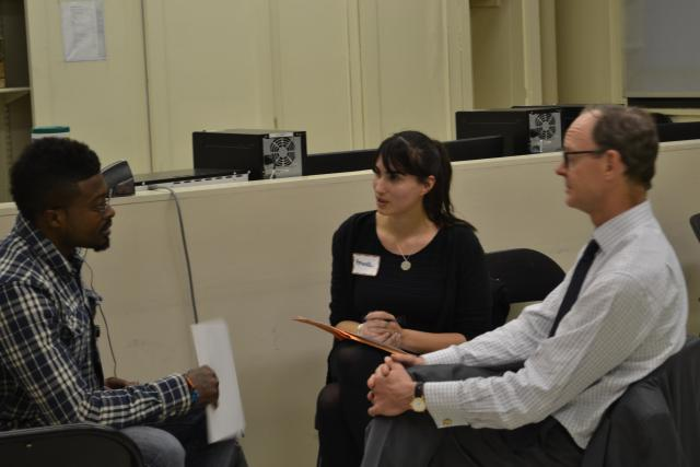 A Harlem Parole Reentry Court participant practices interviewing with Chris Flowers and Amanda Paret of the J.C. Flowers Foundation during Mock Interview Night. (April 8, 2015)