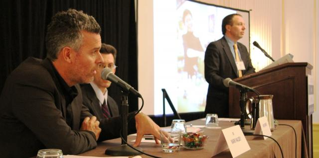 Associate Professor Mark Halsey, left, answers a question as part of a panel on community court research at Community Justice 2012.