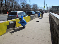 BCS Community Service clients painting over graffiti