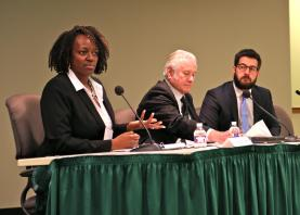 Judge Cheryl Williams of the South Dallas Community Court speaks on a panel about changing offender behavior with Jay Nye (center) of the El Paso County Public Defender's Office and Gregory Midgette of the RAND Corporation.