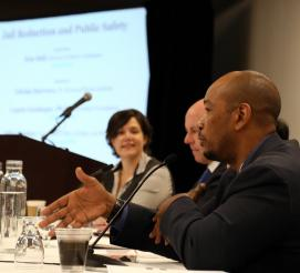 Tshaka Barrows, deputy director of the W. Haywood Burns Institute, speaks during a panel on jail reduction.