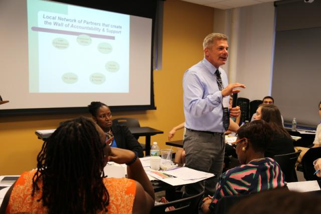 Jim Henderson of the Battered Women's Justice Project discusses the importance of community collaboration in holding domestic violence offenders accountable and keeping victims safe at the Integrated Domestic Violence Court Open House, which was held at the Center for Court Innovation's headquarters in New York City.