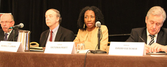 David Fanning, Russell F. Canan, Victoria Pratt, and David Fletcher participate in a panel for judges and magistrates at the International Conference of Community Courts in Washington, D.C.