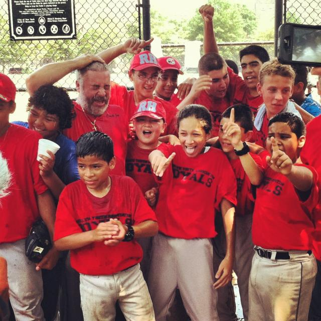 After a 3-hour game, the Red Hook baseball league's BYA Royals celebrate their win. In 2012, the Red Hook league celebrates 15 years of enhancing the lives of kids, coaches, and the Red Hook community. (July 11, 2012)