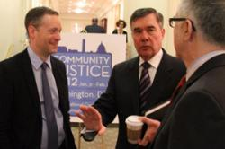 R. Gil Kerlikowske of the White House Office of National Drug Control Policy, center, speaks with Greg Berman, left, and Julius Lang of the Center for Court Innovation.