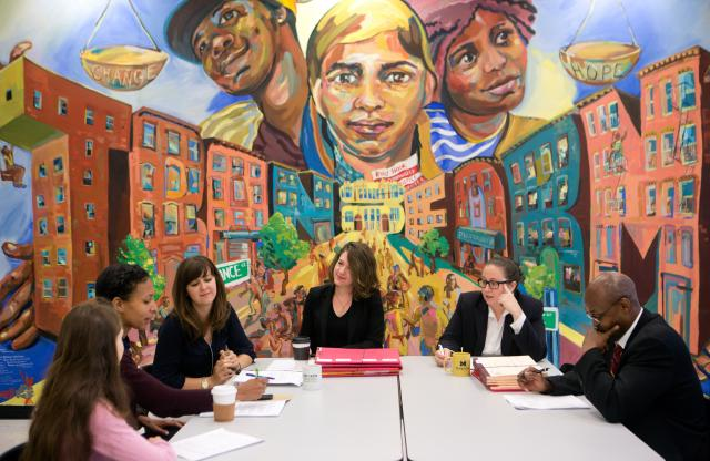Representatives from the Brooklyn District Attorney's office, New York State Office of Administration, and Legal Aid meet at the weekly Treatment Conference convened by the Alternatives to Incarceration department at the Red Hook Community Justice Center to discuss cases in-depth and provide training on clinical issues.
