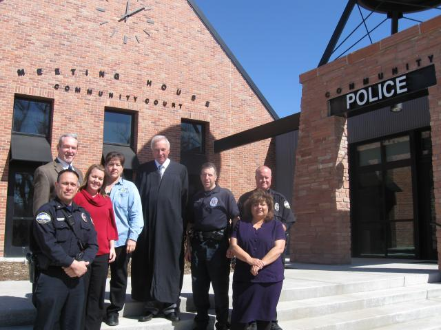 Jim Burack, third from right, says the new combined courthouse/police station fosters inter-agencycollaboration.         With Burack are, from left, Benito Garcia, Commander, Police Dept., Bruce Fickel, Community Prosecutor, Jessica Jones,         Community Court Case & Resource Manager, Maria Zuniga,Community Services Assistant, Police Dept., John         Easley, Community Court Judge, Beatriz Rangel,Community Court Clerk, and Mick Peters, School Resource Officer.