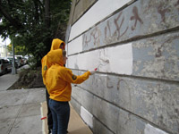 Members remove graffiti in Queens.