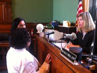 Judge Kelly O'Neill Levy discusses a case with her law clerk and resource coordinator.