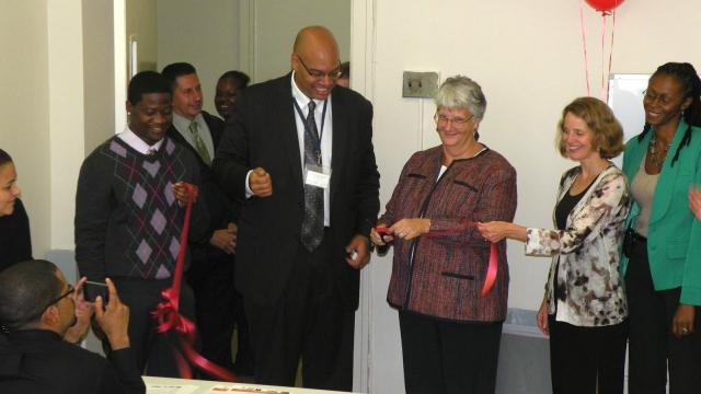 Prisoner Reentry Institute Director Ann Jacobs cuts the ribbon on the Harlem Justice Corps office. Part of the New York City Justice Corps initiative, the Harlem Justice Corps is an intensive career development and service program for justice-involved young adults. Jacobs is joined by Chris Watler, director of the Harlem Community Justice Center, Marta Nelson, executive director for the Center for Employment Opportunities in New York City, Reion Evans, coordinator at Literacy Partners Push Center Community Partnership, and a Corps member. (October 10, 2012)