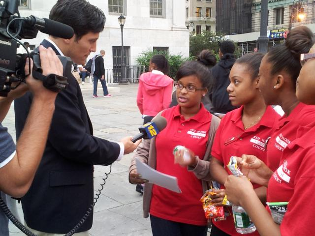 Youth court members from the Red Hook Community Justice Center are interviewed by Channel 12 about the Brooklyn Youth Summit, where they promoted the Red Hook Youth Court and connected with New Yorkers Against Gun Violence, Green City Force, and the NYPD Explorers program. (October 17, 2012)