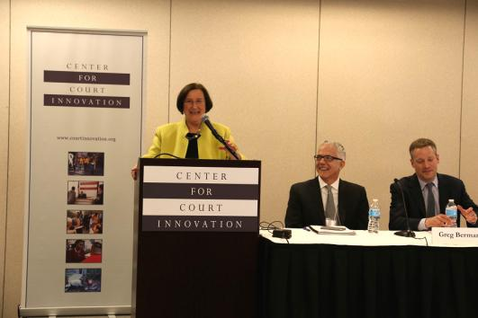 At Community Justice 2016: Above, Denise O'Donnell, director of the Bureau of Justice Assistance,         delivers her keynote address. Below left, Jose Egurbide of the Los Angeles City Attorney's Office participates         in a panel on Restorative Justice. Right, Mark Kammerer of the Cook County State's Attorney's Office         discusses Risk/Needs Assessments on a panel.