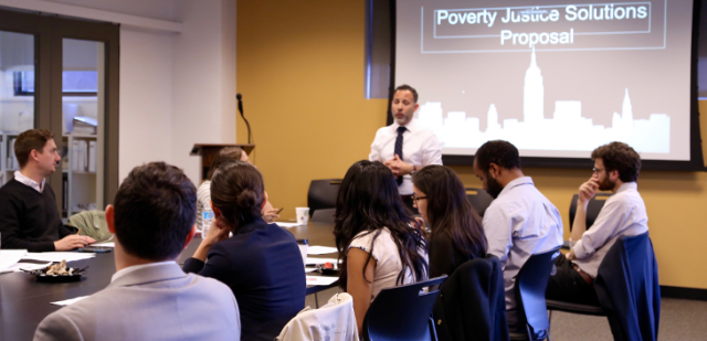 Poverty Justice Solutions Director Ignacio Jaureguilorda discusses reforms to increase procedural justice in Housing Court at a workshop for Poverty Justice Solutions fellows.