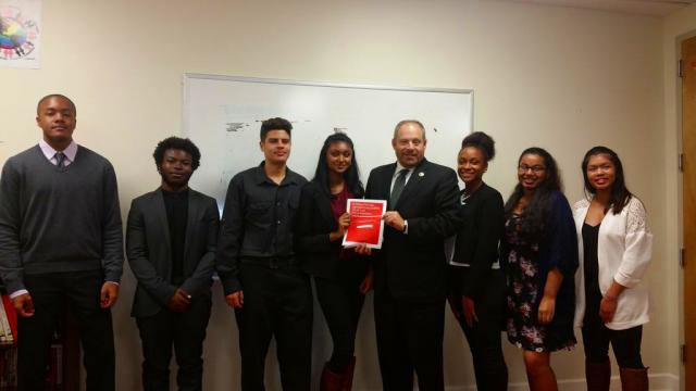 "New York City Council member Rory Lancman joins members of the Queens Youth Justice Council at the presentation of the Youth Justice Council's report, ""Bridging the Gap: Strengthening LGBTQ Youth and Police Relations."""
