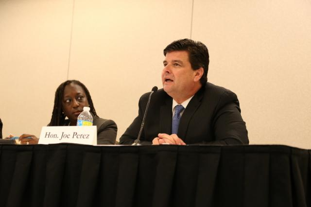 Judge Joe Perez speaks during a panel on race and legitimacy at Community Justice 2016.