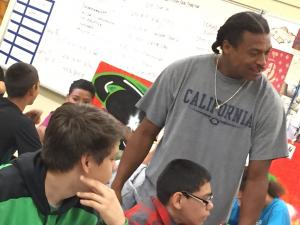 Facilitator leads a session of the Men's Leadership Academy in a local middle school.