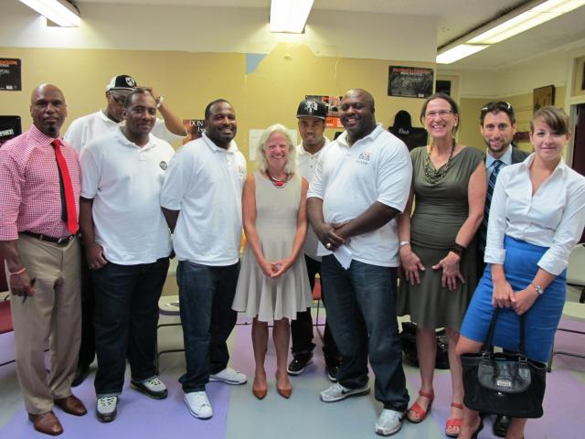 New York City Deputy Mayor Linda Gibbs, center, visits with staff of Save Our Streets Crown Heights at the Crown Heights Community Mediation Center to learn how the program works to reduce shootings and killings in the neighborhood. (September 12, 2012)