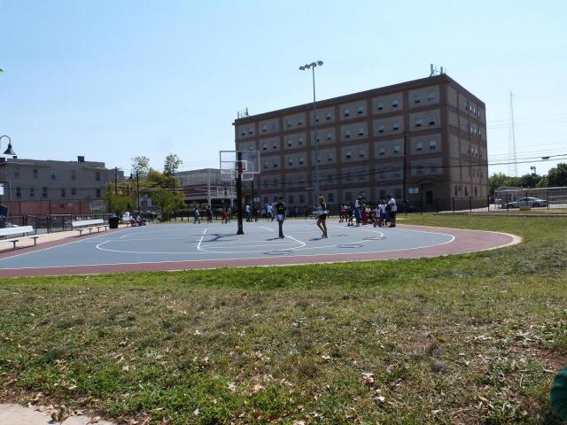 In Newark, a community service field day started with a community service crew cleaning up Boys Park and ended with a series of field day events. Here, neighborhood kids enjoy games led by youth court members from Newark Community Solutions. (September 26, 2012)
