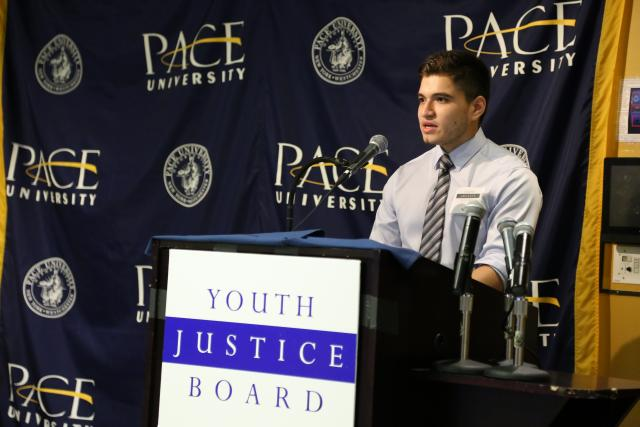 "Neil, 16, a member of the Youth Justice Board, offers one of the Board's policy recommendations at the presentation of its report, ""Stepping Up: Strengthening Police, Youth, and Community Relations,"" at Pace University. (June 18, 2015)"