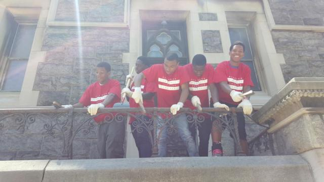 Red Hook Community Justice Center interns, neighborhood restitution crew, and supervisors do community service at Red Hook's St. Agnes Roman Catholic Church.