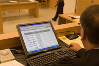 Judge Matthew D'Emic uses a computer application to help manage cases.