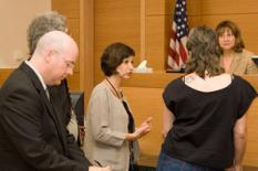 Project director Lucille Jackson confers with a client in court.