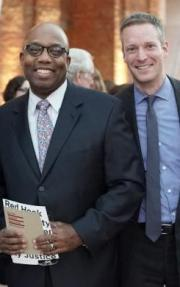 Errol Lewis with Center Director Greg Berman.