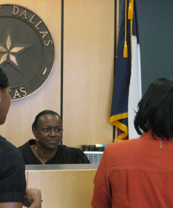South Dallas Community Court Judge Cheryl Williams listens to a court participant.