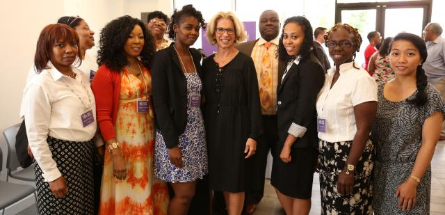 New York State Chief Judge Janet DiFiore spoke at the inauguration of Legal Hand at the Brownsville Community Justice Center. Here, she takes a photo with staff and volunteers of Legal Hand and Legal Aid.