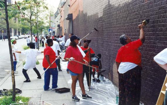 From the archives: The Red Hook Public Safety Corps removes graffiti from the wall of a local supermarket during a day of service in the neighborhood.