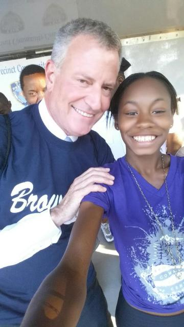 Mayor Bill de Blasio poses with Chanel Simpson, a youth participant at the Brownsville Community Justice Center, during the National Night Out Against Crime. (August 10, 2015)