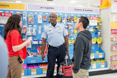 "Youth and police officers visit Target for Stand Up Participate's back-to-school ""Shop-With-A-Cop"" event"