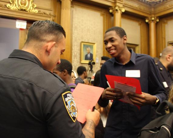 Neighborhood Coordination Officer Ingoglia and Red Hook Youth Court member Mehki
